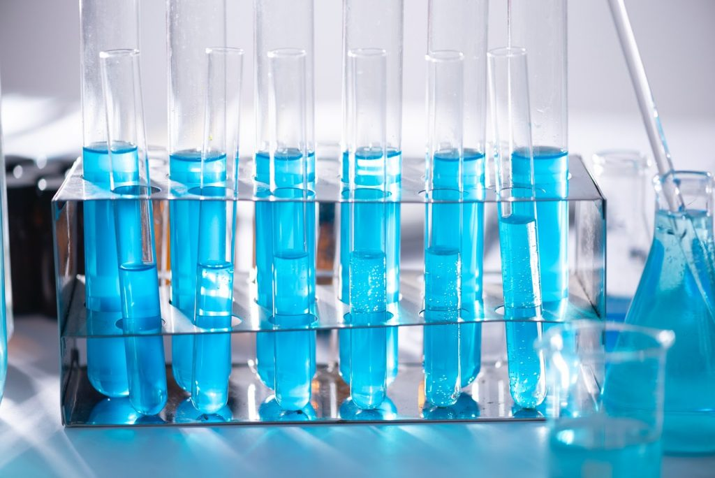 clean vials with blue liquid testing for hard water