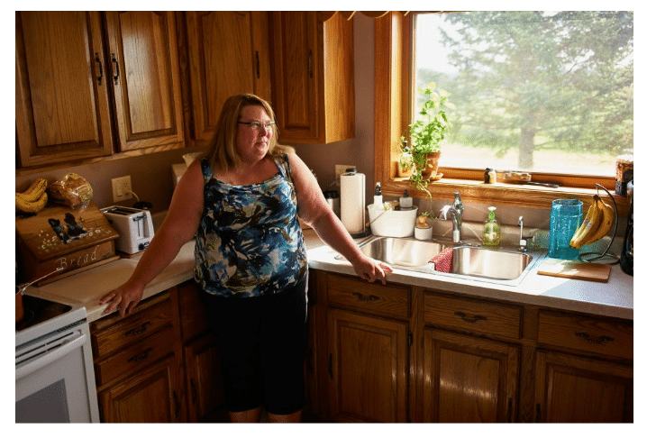 woman in a kitchen talking about water problem