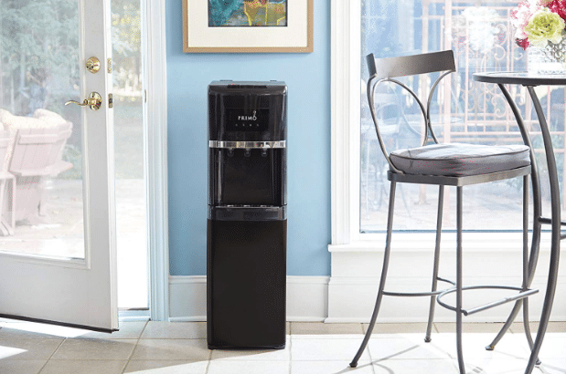 black Primo water cooler in a kitchen with lots of sunlight