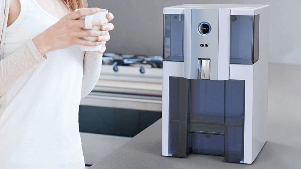 image of woman holding coffee beside AlcaPure Zero Installation Purifier