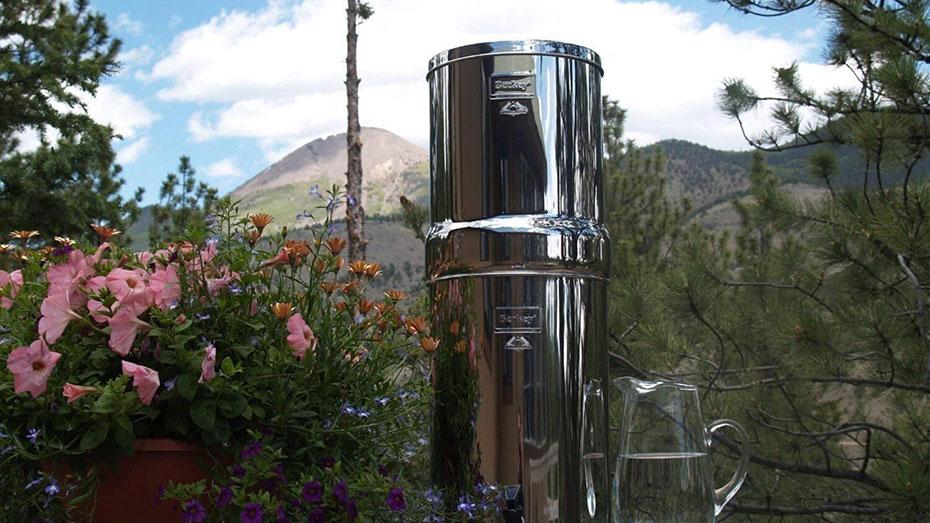 image of crown berkey water filter beside water jug